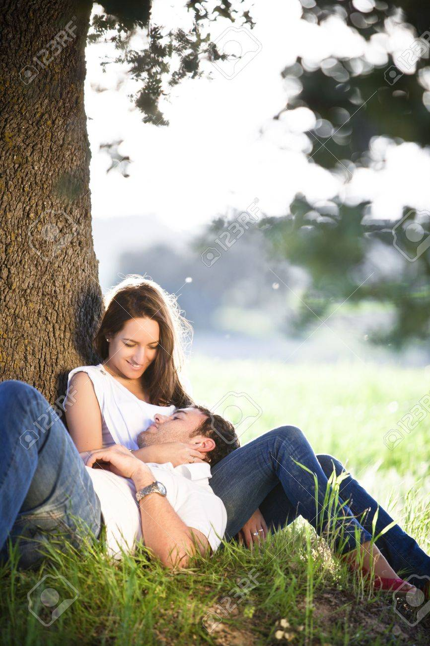 Young beautiful couple resting under a tree Stock Photo - 6965974