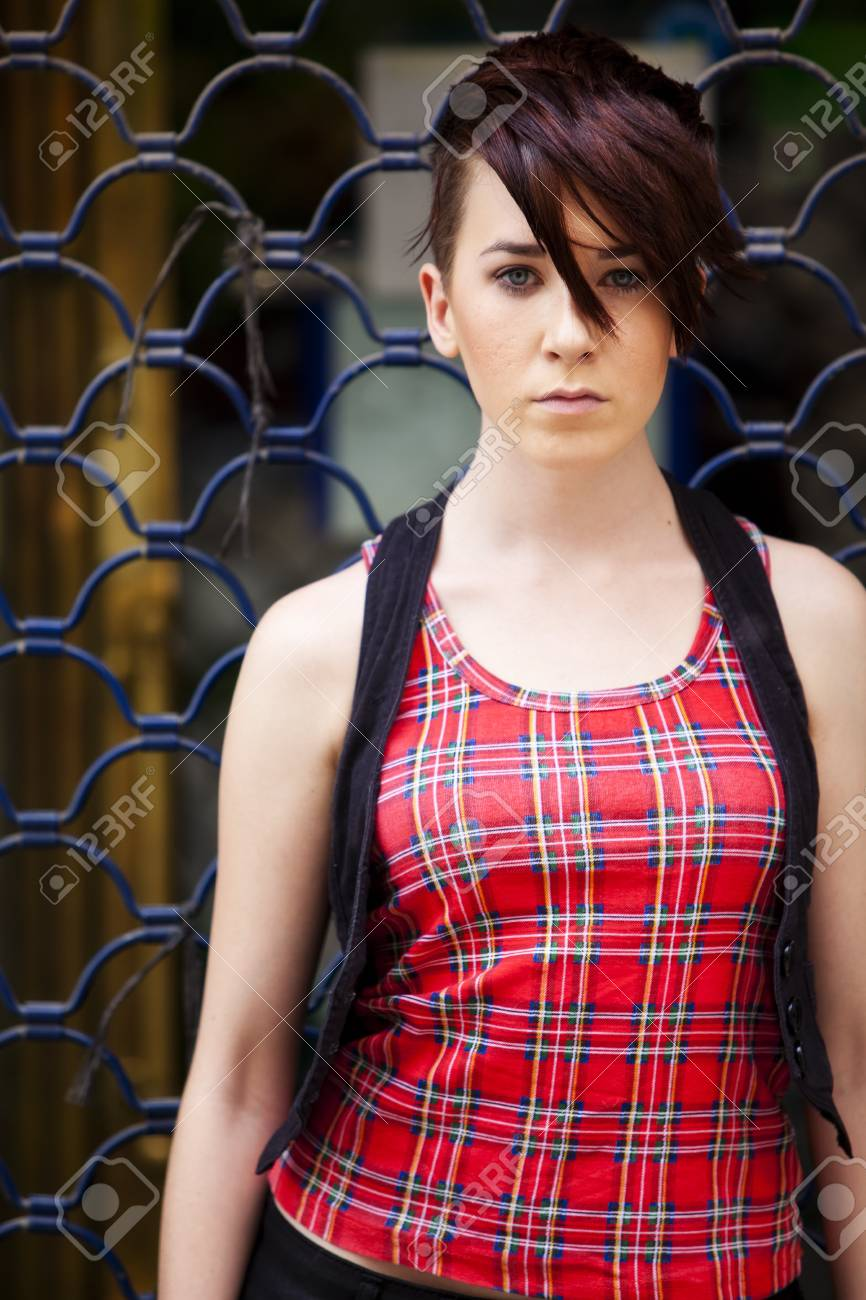 Young modern looking girl over urban background Stock Photo - 8765064