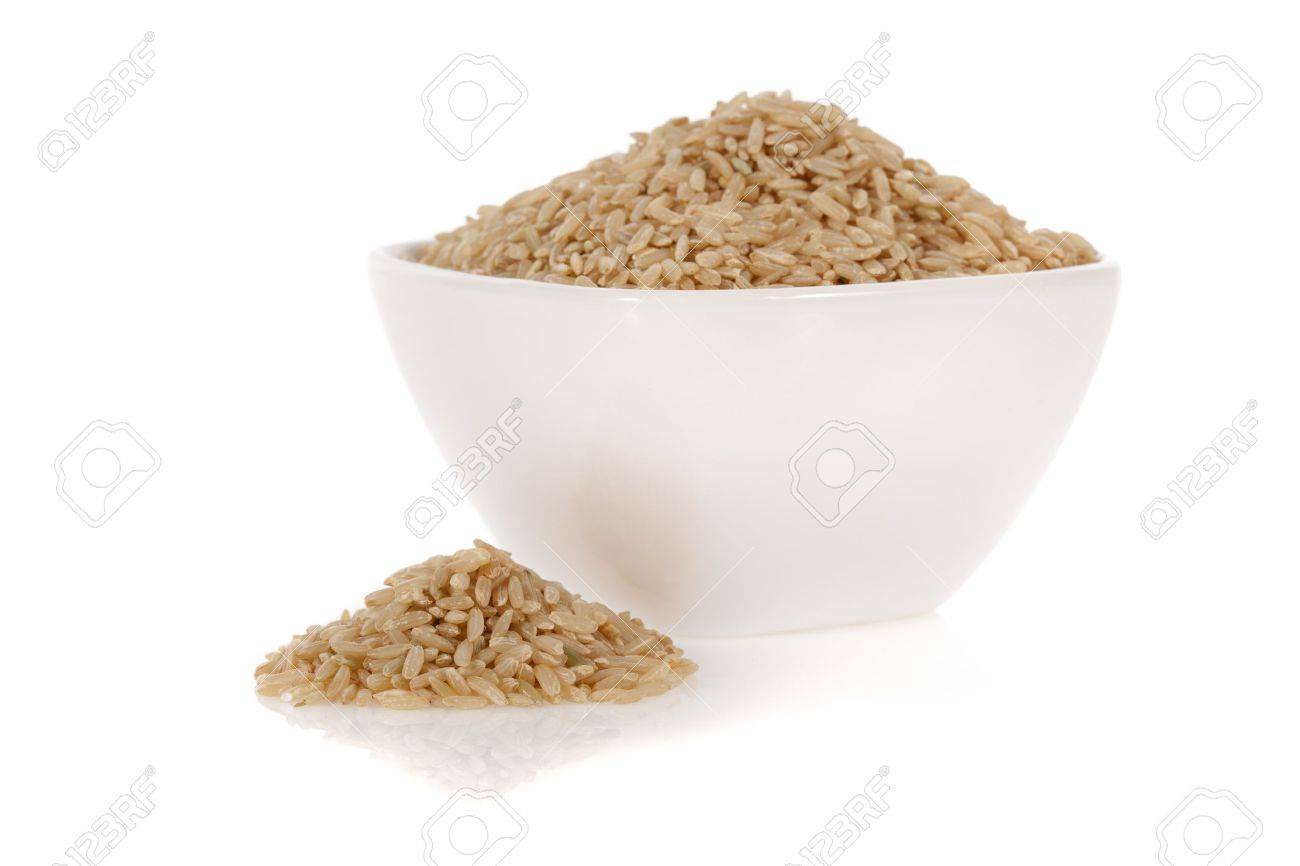 Brown rice in a bowl isolated on a white background Stock Photo - 9536297