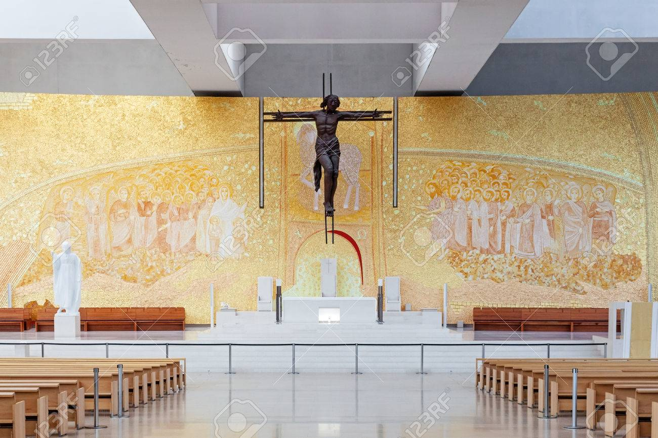 Sanctuary of Fatima, Portugal. Basilica of Most Holy Trinity altar. Crucifix by Catherine Greene and Back Wall by Marko Ivan Rupnik. Fatima is a major Marian Shrine pilgrimage site Stock Photo - 38896906