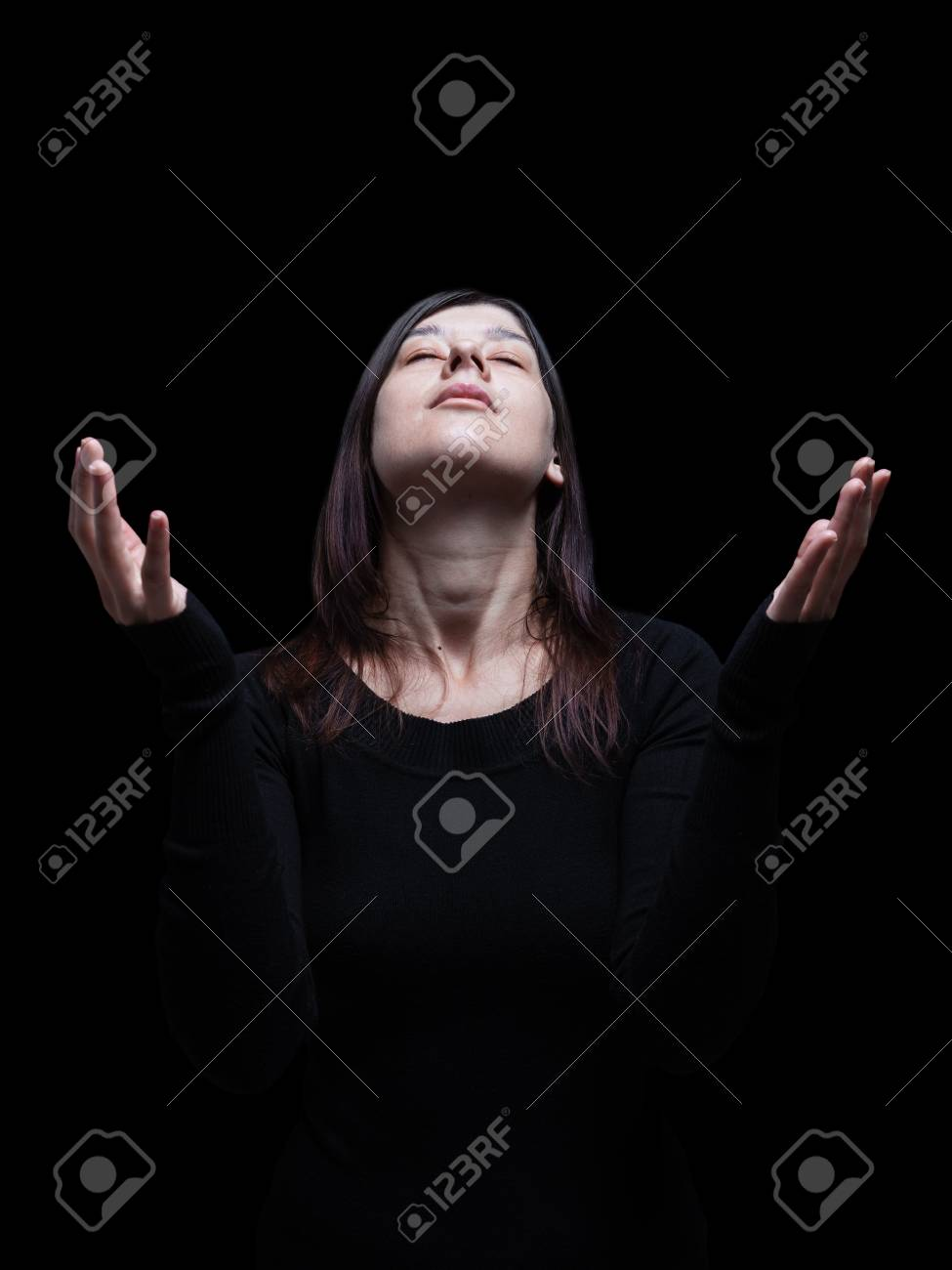 Mourning woman praying, with arms outstretched in worship to