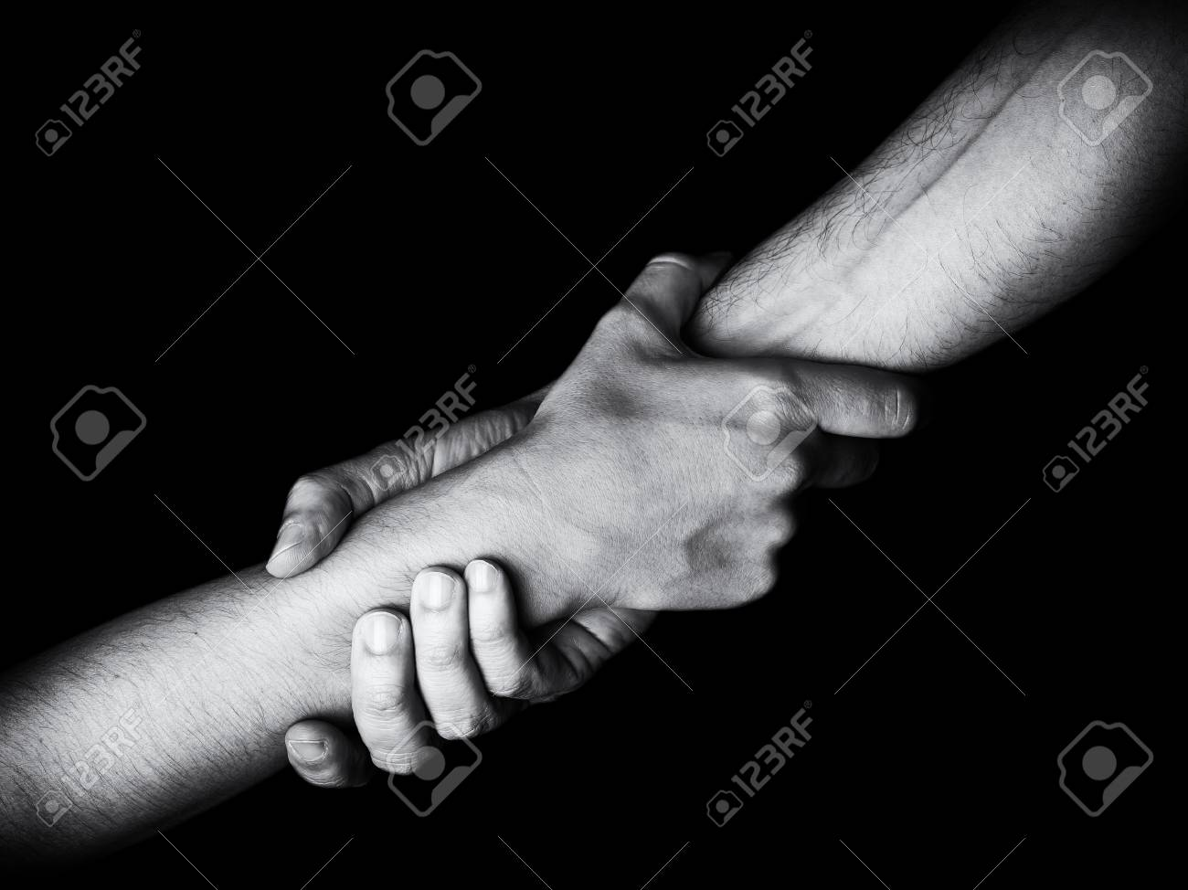 Man saving, rescuing and helping woman by holding or griping the forearm. Male hand and arm pulling up female. Concept of rescue, love, friendship, support, teamwork, partnership, reaching, couple - 91296702