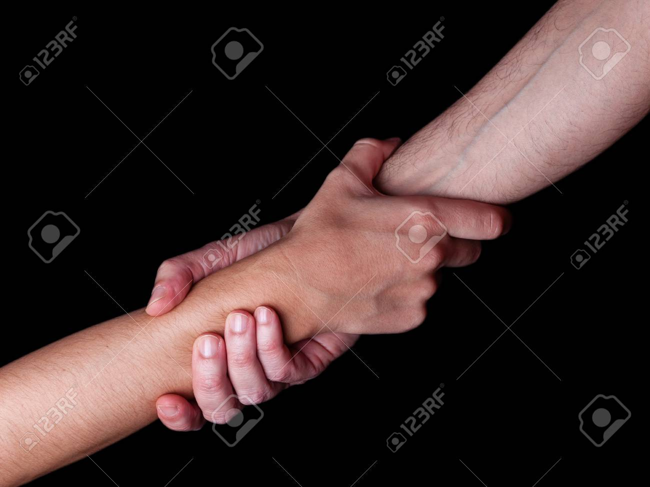 Man saving, rescuing and helping woman by holding or griping the forearm. Male hand and arm pulling up female. Concept of rescue, love, friendship, support, teamwork, partnership, reaching, couple - 91318734