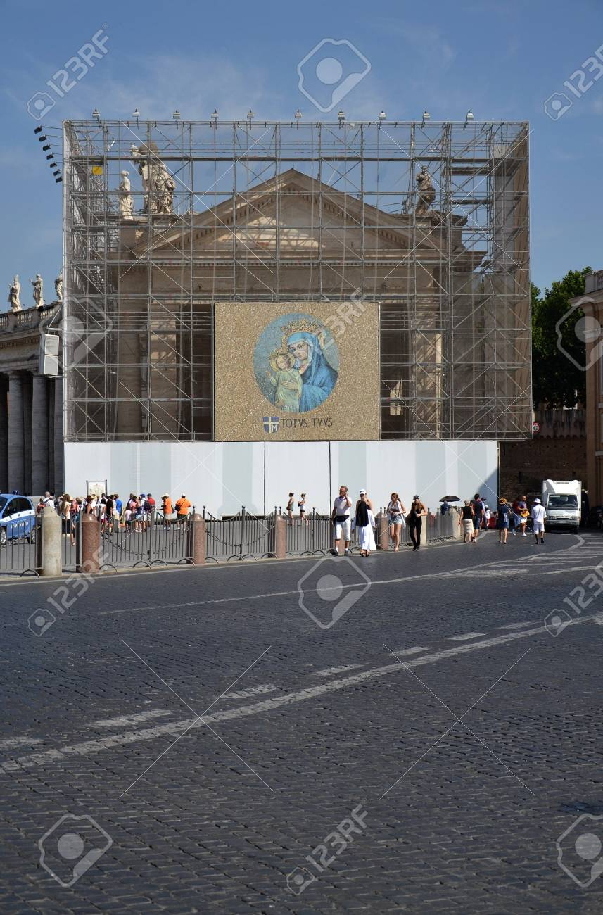 Rome, Italy - July 11, 2012: Tourists in front of facade at Saint Peter Stock Photo - 15951122