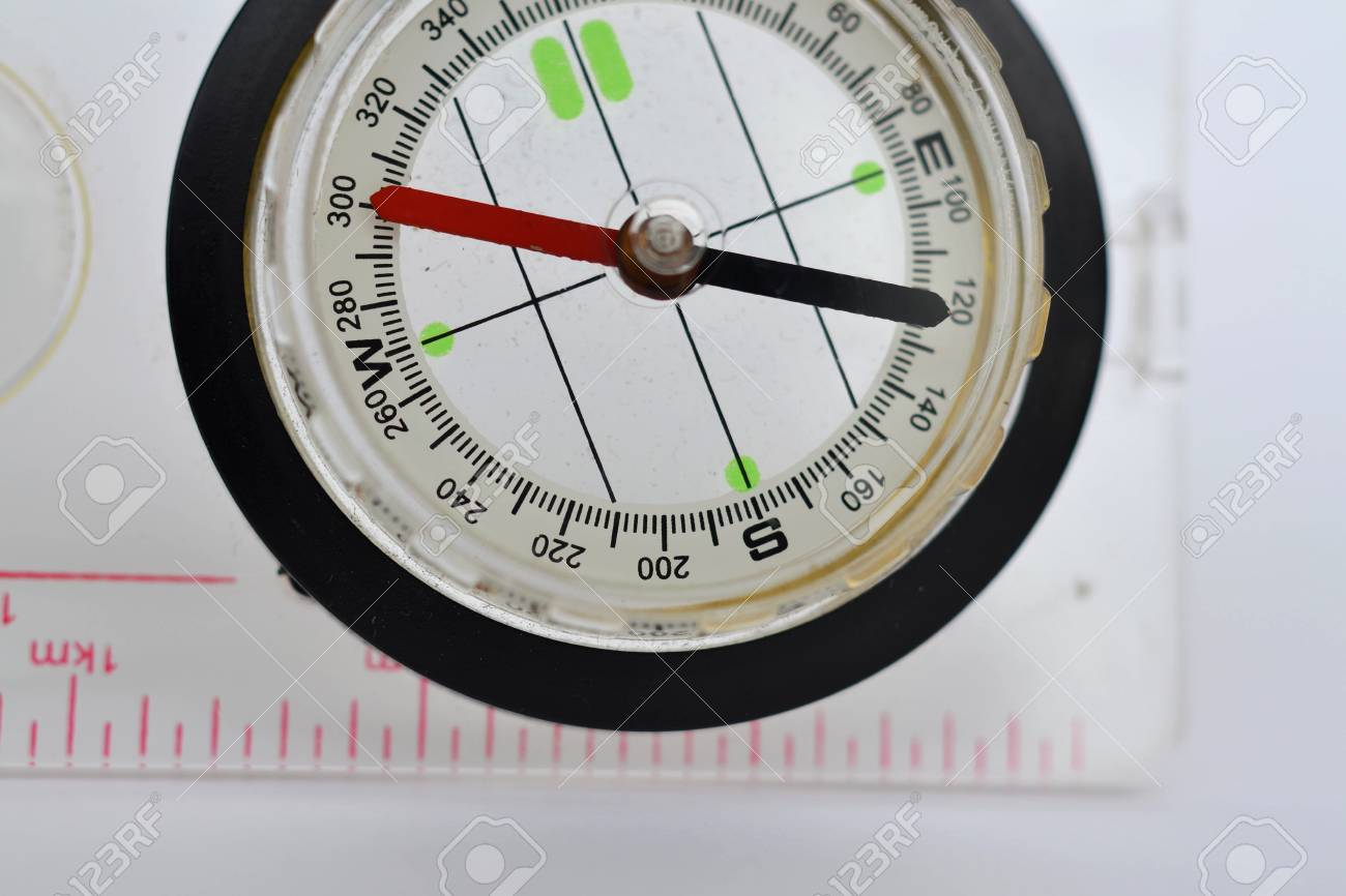 Detail shot of a glass compass on white background Stock Photo - 16750416