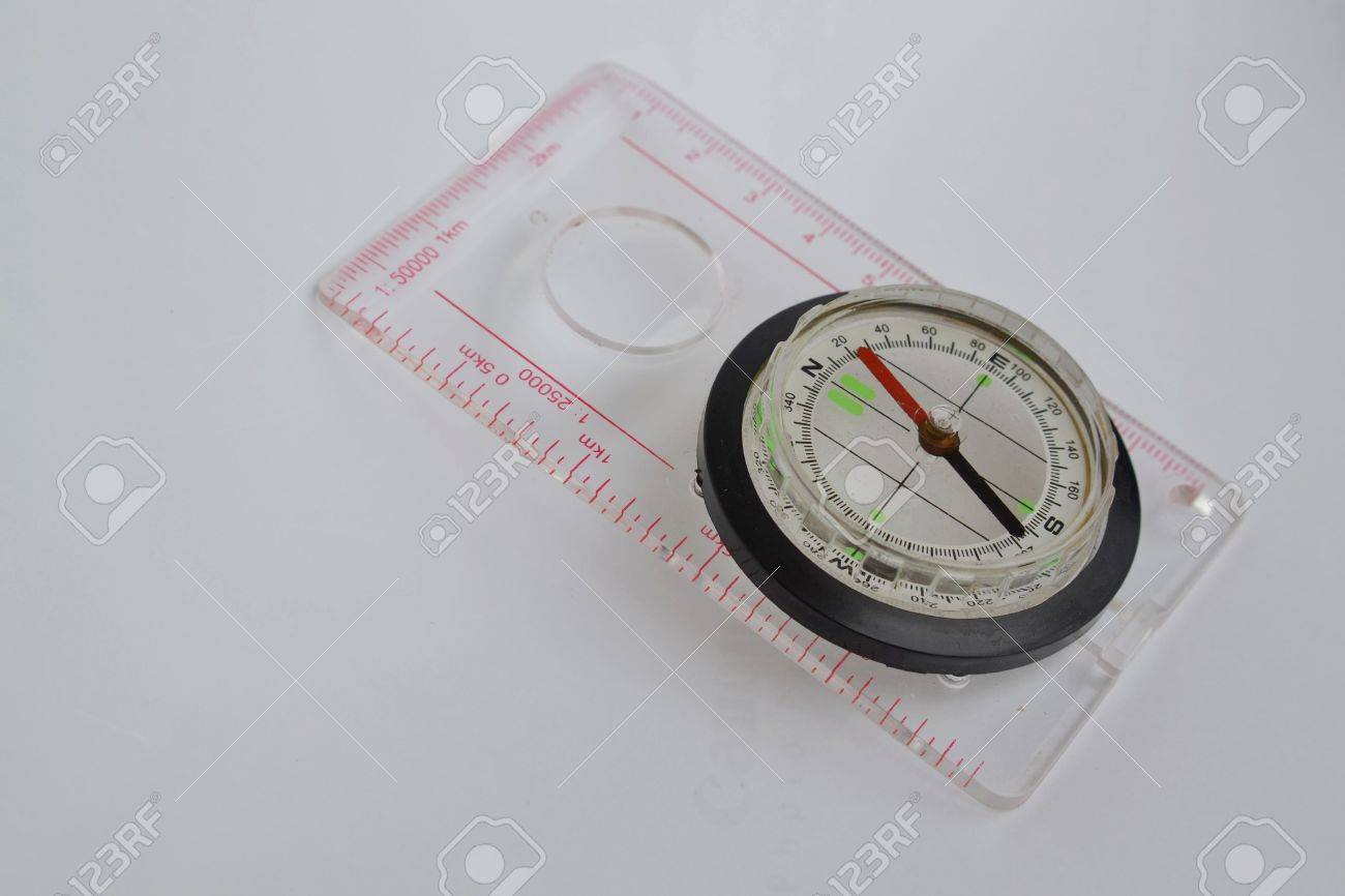 Detail shot of a glass compass on white background Stock Photo - 16750385