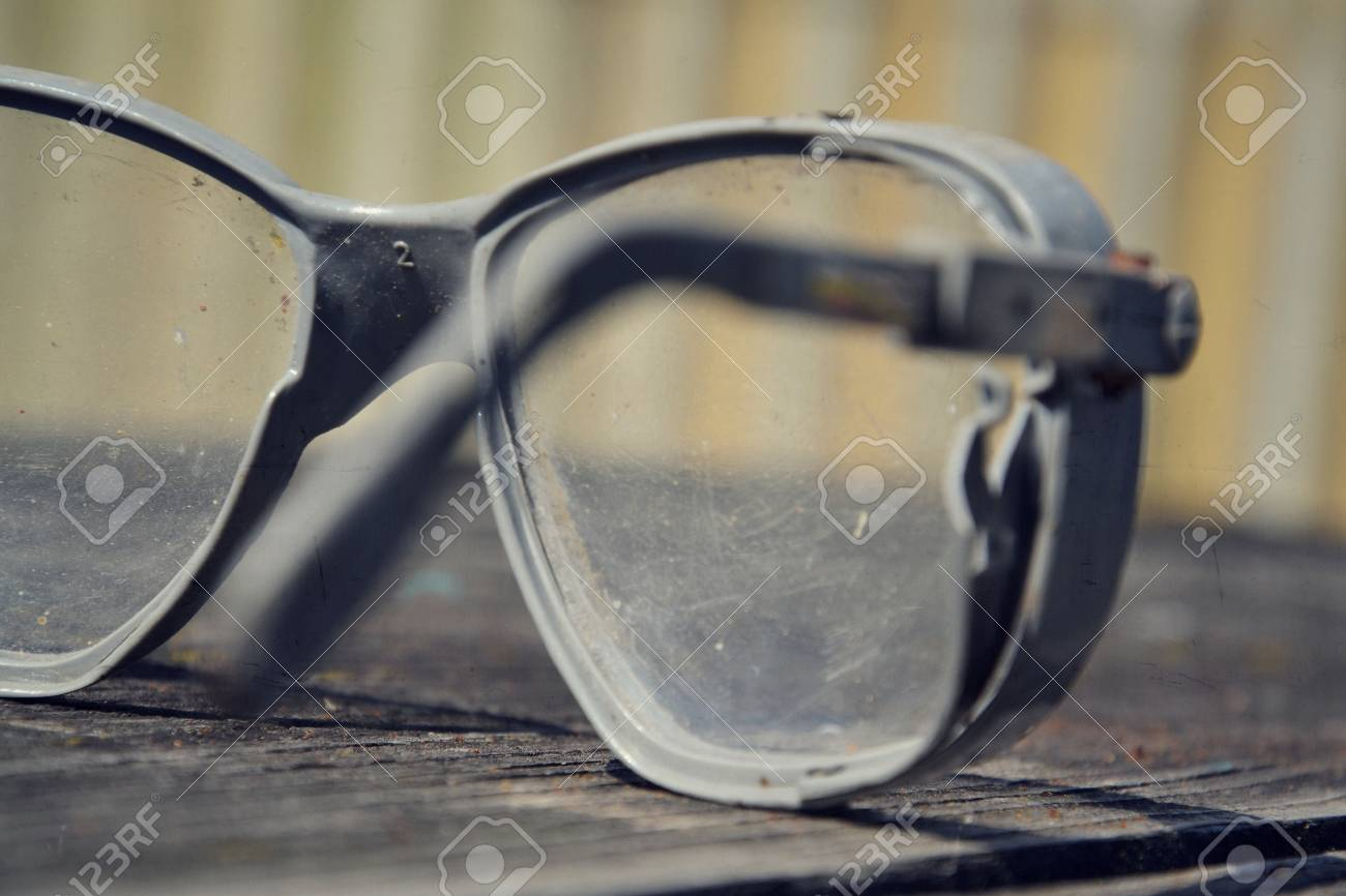 8f1667c91d Filtered picture of a vintage safety glasses on a wooden table Stock Photo  - 33903134