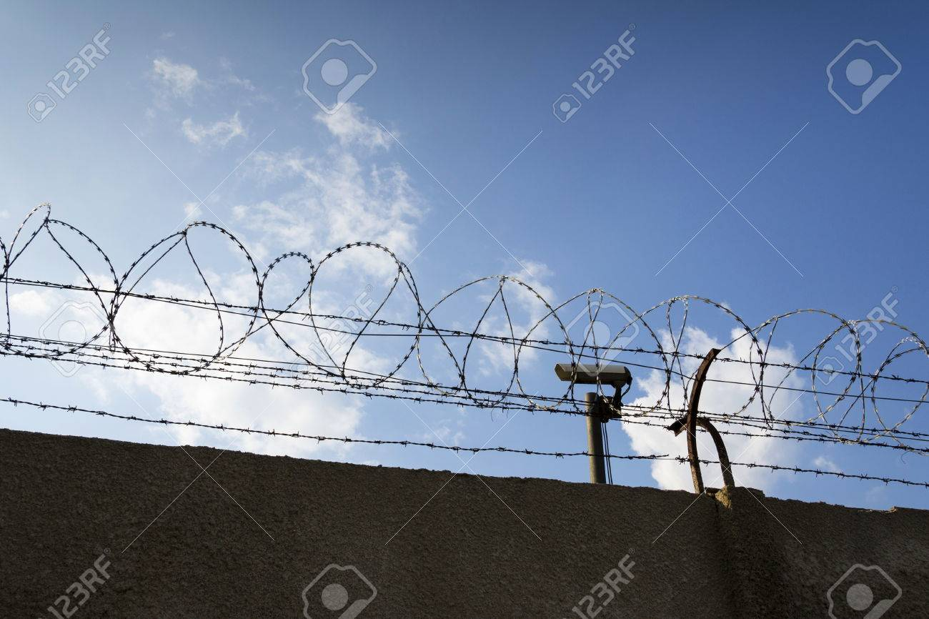 Security Camera Behind Barbed Wire Fence Stretched Around Prison ...