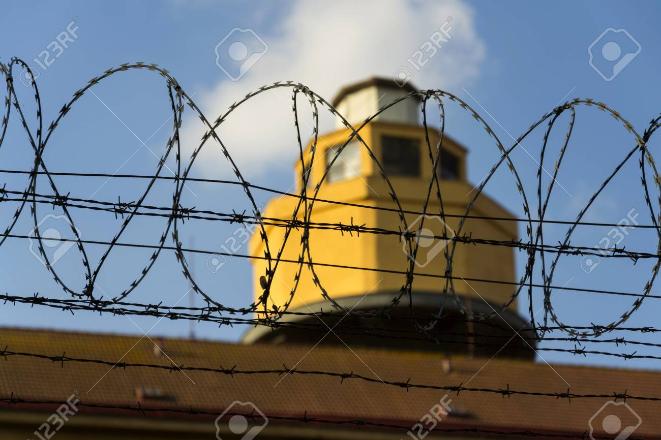 Guarding Tower Behind Barbed Wire Fence Stretched Around Prison ...