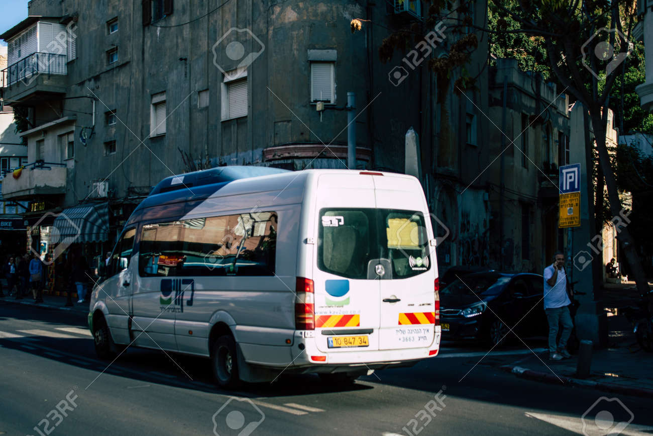 Tel Aviv Israel December 02, 2019 View of a traditional Israeli public city bus rolling in the streets of Tel Aviv in in the afternoon - 146752671