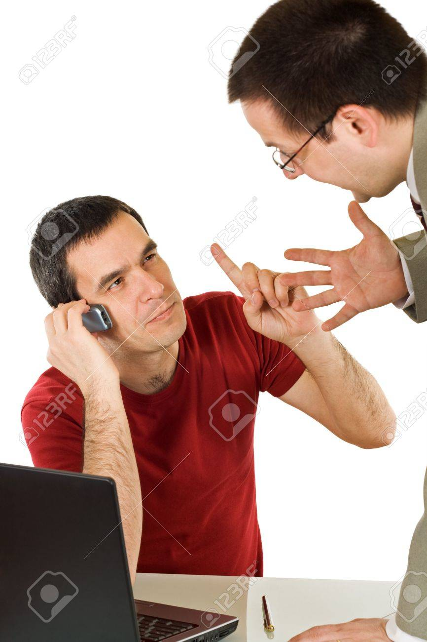 The employee talking by phone with somebody while his boss try to explain nervously him something Stock Photo - 4746863