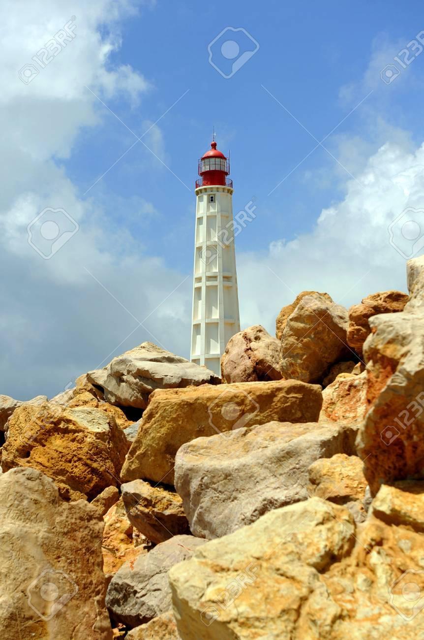 Maritime lighthouse, Farol Island, region of Algarve, southern Portugal, Europe Stock Photo - 26055979
