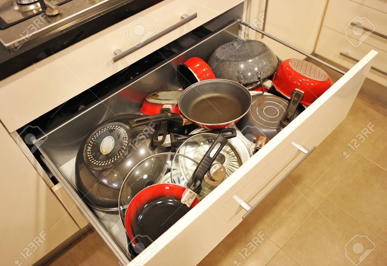 Drawer Kitchen Cabinet Full Of All Kinds Of Pots And Pans