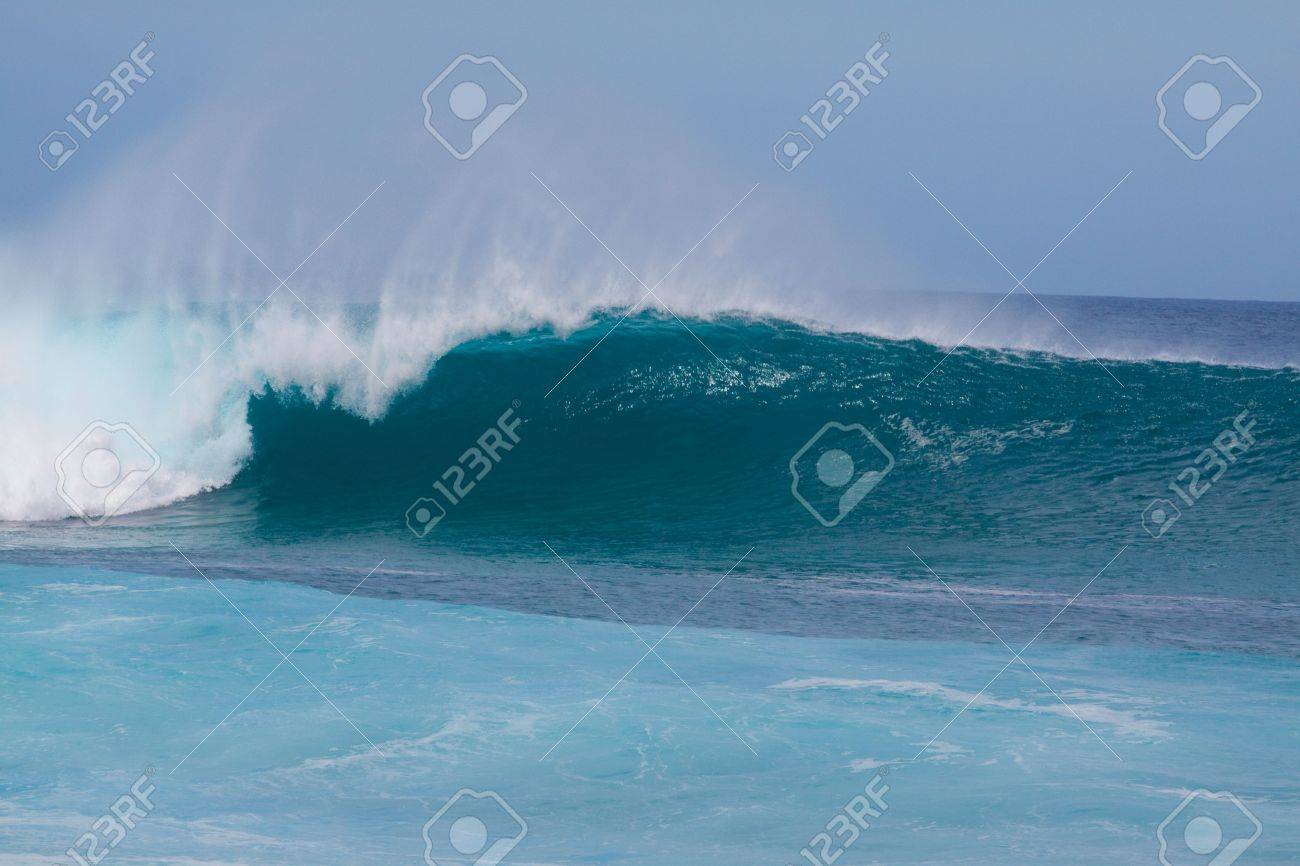 Large waves break off the north shore of oahu hawaii during a great time for surfers surfing. Stock Photo - 5822440
