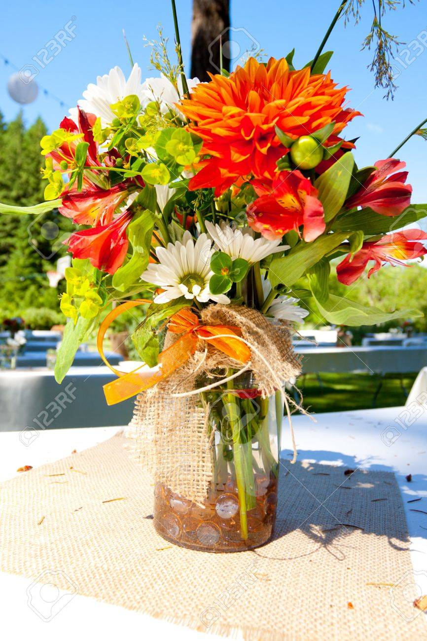 White Orange And Green Wedding Flower Arrangements With Burlap