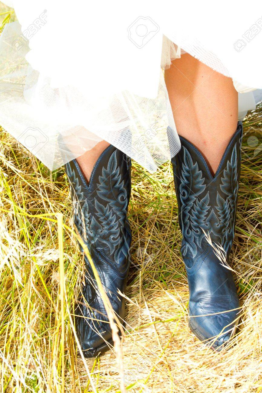 A Bride Wearing Her Black And Blue Cowboy (or Cowgirl) Boots ...