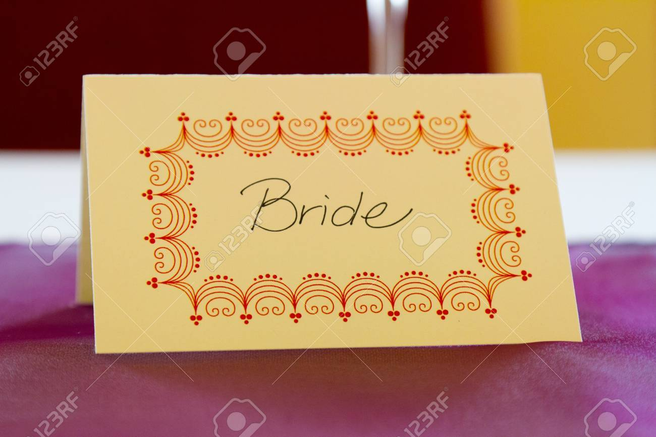 This name tag says bride to reserve her spot at a wedding dinner table. Stock Photo - 17100717