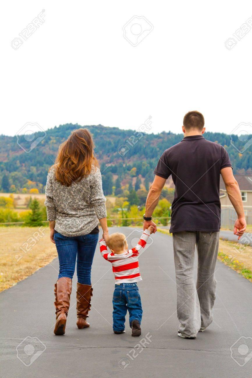 a Family Walks Away on a Path