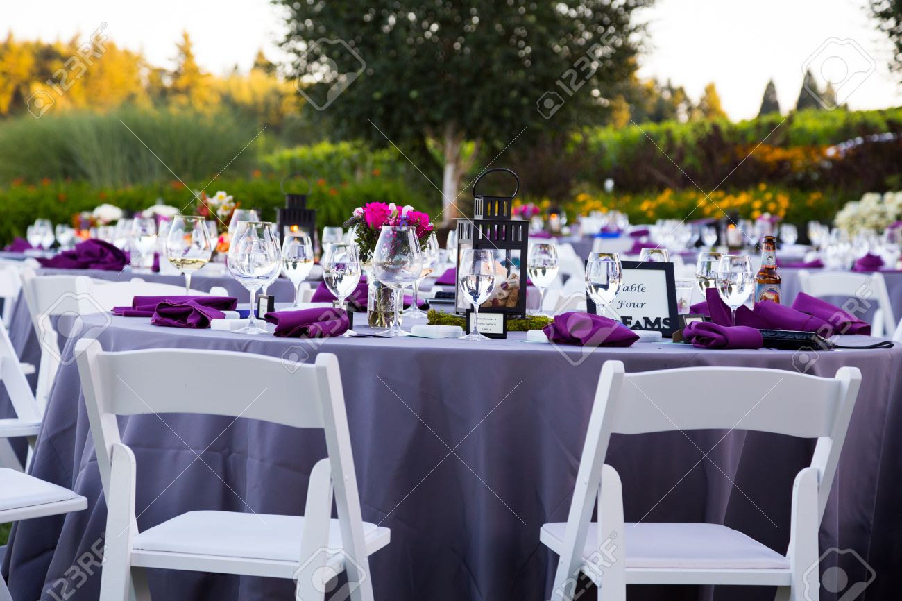 Tables chairs decor and decorations at a wedding reception stock photo tables chairs decor and decorations at a wedding reception at an outdoor venue vineyard winery in oregon junglespirit Choice Image