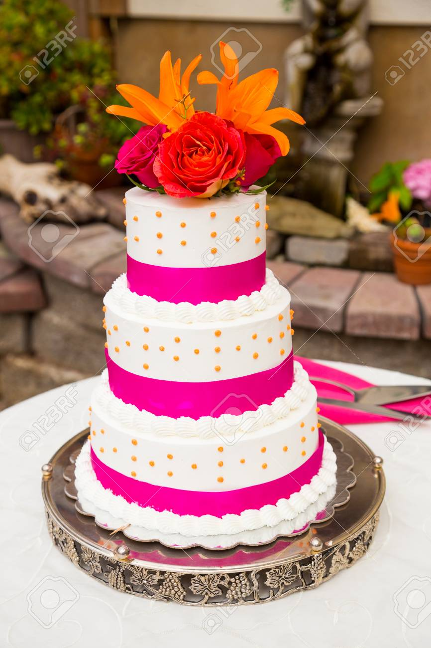 A Beautiful Wedding Cake Is Set Up At The Reception For A Bride ...