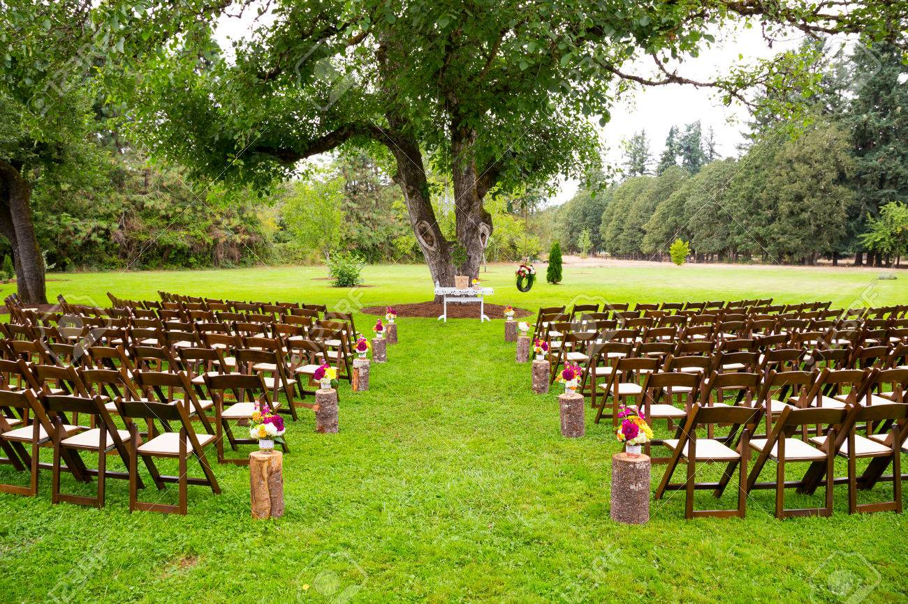 Wedding ceremony chair - A Beautiful Country Wedding Venue Location Is Setup For The Ceremony With Chairs And Decorations Awaiting