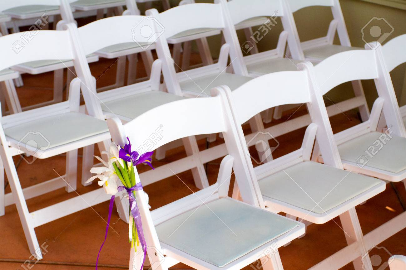Wedding ceremony chair - Stock Photo White Wedding Venue Chairs Are Setup And Ready In Rows Waiting For Guests To Arrive For The Ceremony
