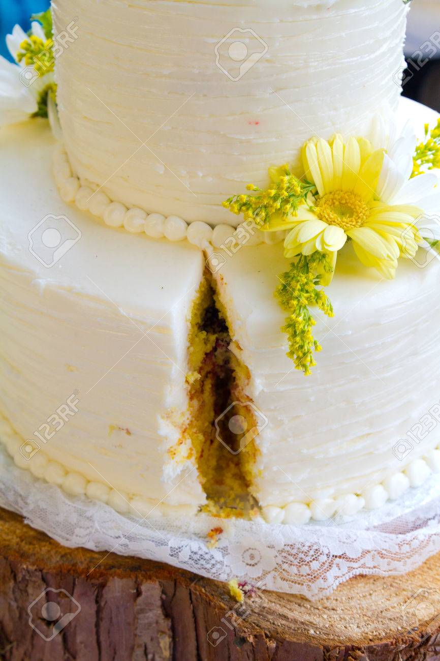 Beautiful White Wedding Cake In Detail At A Reception For The ...
