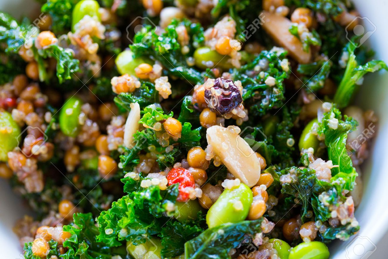 Raw paleo quinoa kale salad in a bowl. Healthy eating diet food. - 27539320