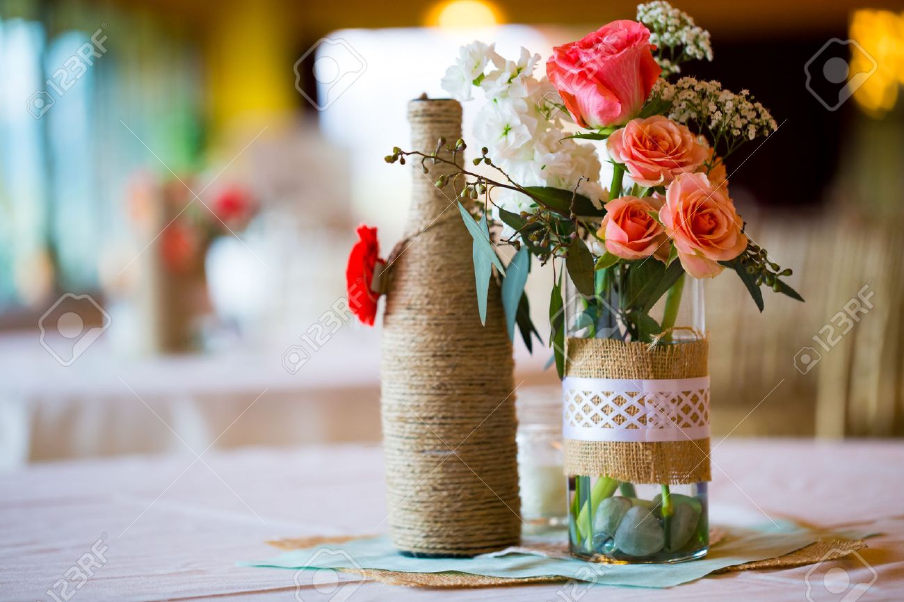 DIY Wedding Decor Table Centerpieces With Wine Bottles Wrapped ...