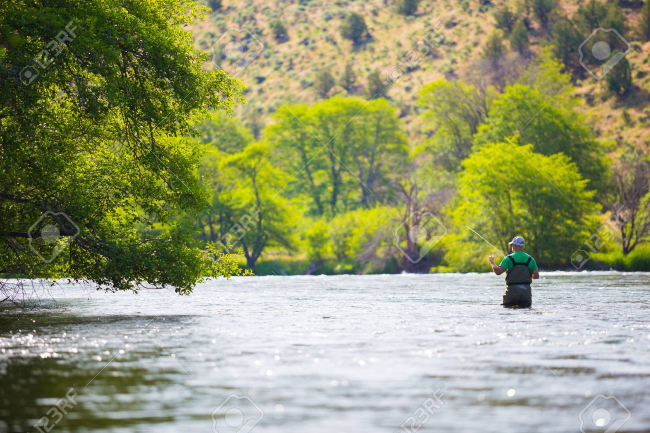 Experienced fly fisherman fishing the Deschutes River in Oregon,