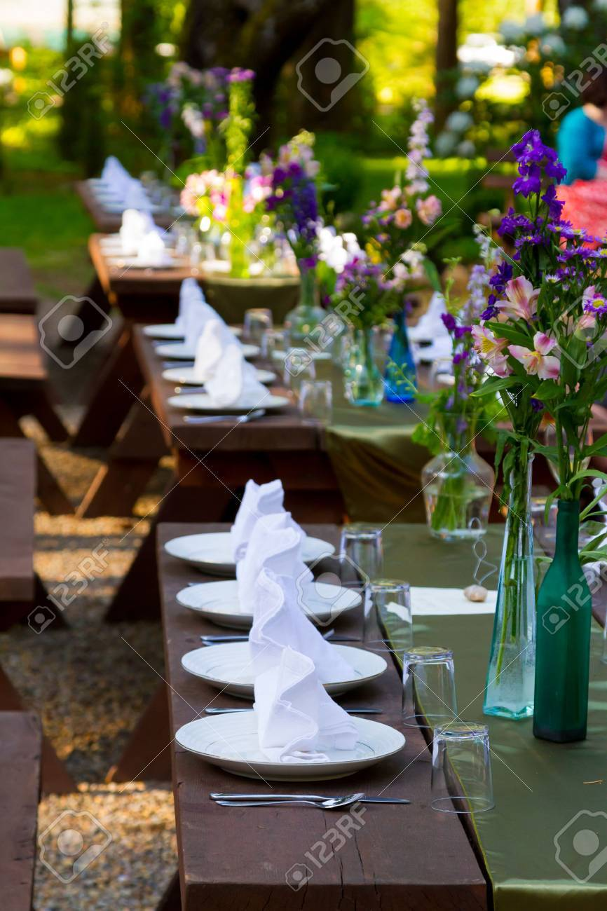 Place Settings Ready For Guests At A Wedding Reception Outdoors