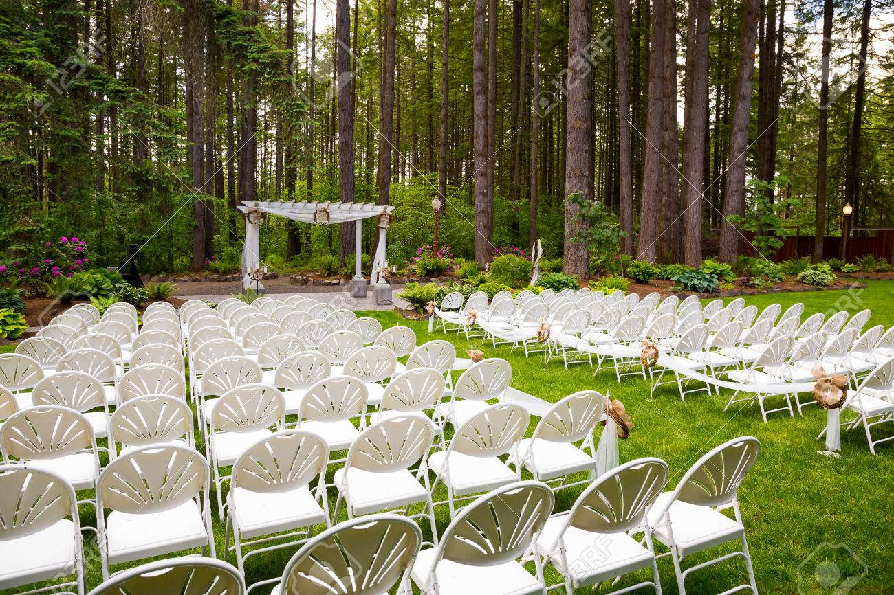 Wedding venue in Oregon has natural trees and beautiful guest seating amidst tall trees. - 46923916