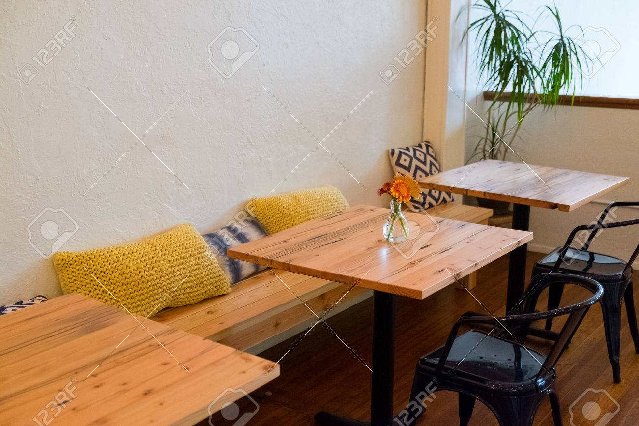 Picture of: Bench Seating At A Coffee Shop Restaurant With Small Cafe Tables Stock Photo Picture And Royalty Free Image Image 66548640