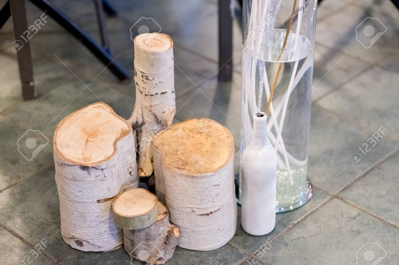 Cross Cut Birch Tree Rounds Used For Wedding Decor At A Ceremony