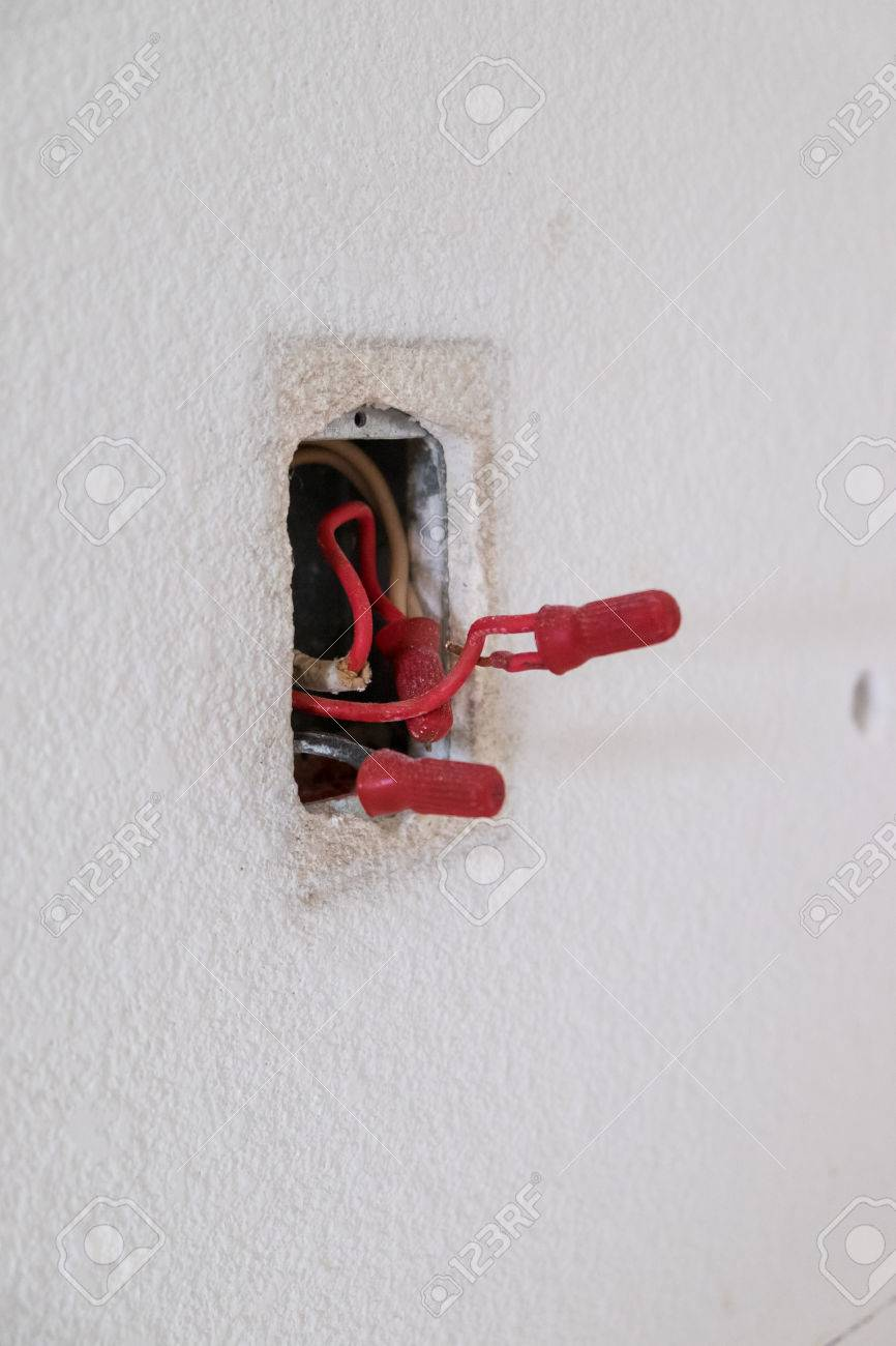 electrical wires exposed in a junction box during a major house renovation   stock photo -