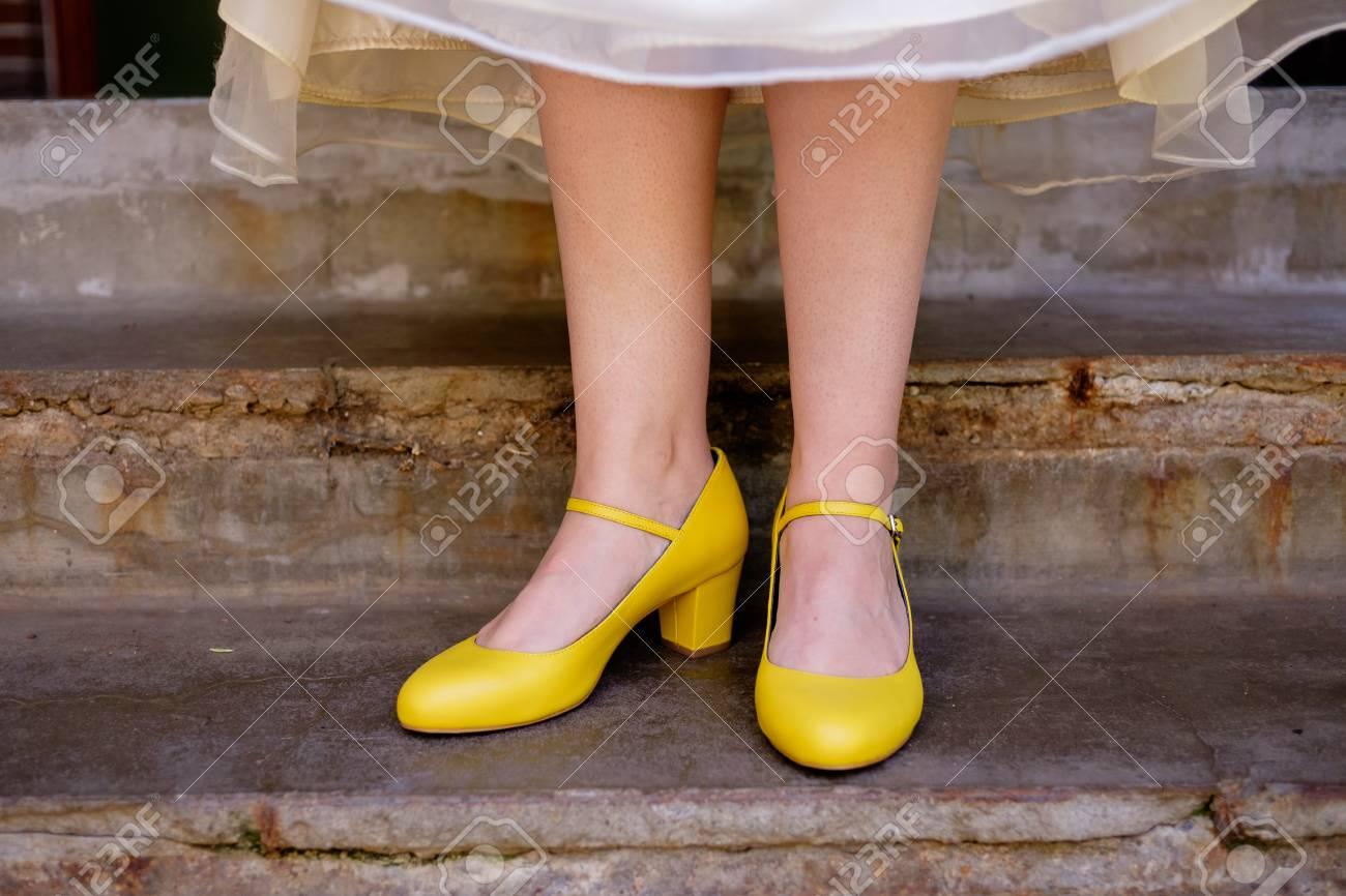 0142376df Bride Yellow Wedding Shoes Stock Photo - 77769462
