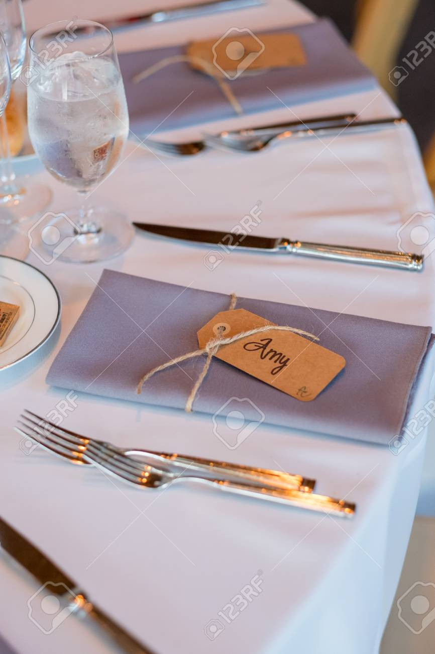 folded napkins with name tags at reception stock photo picture and