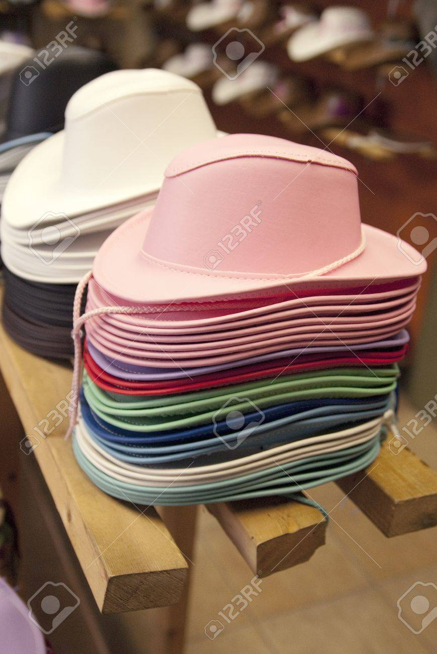 65d574965715f Stock Photo - This is some stacks of colorful cowboy hats for kid in a store  of the western festival of St-Tite.