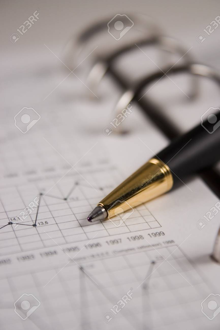 Stock chart with a pen Stock Photo - 2338559