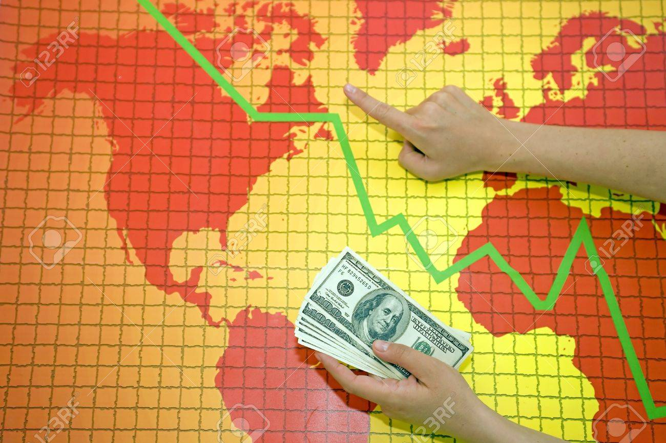 Money at the world map with falling diagram Stock Photo - 11057816