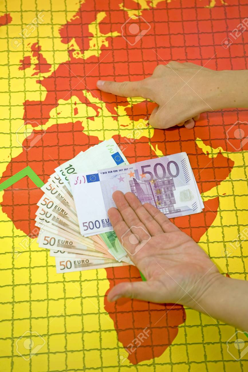Money at the world map with falling diagram Stock Photo - 11057867