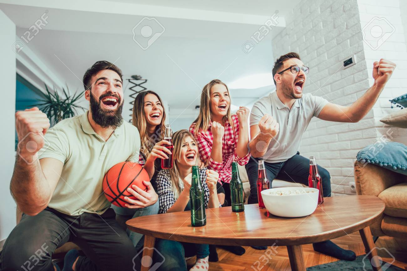 Happy Friends Or Basketball Fans Watching Basketball Game On Stock Photo Picture And Royalty Free Image Image 93317739