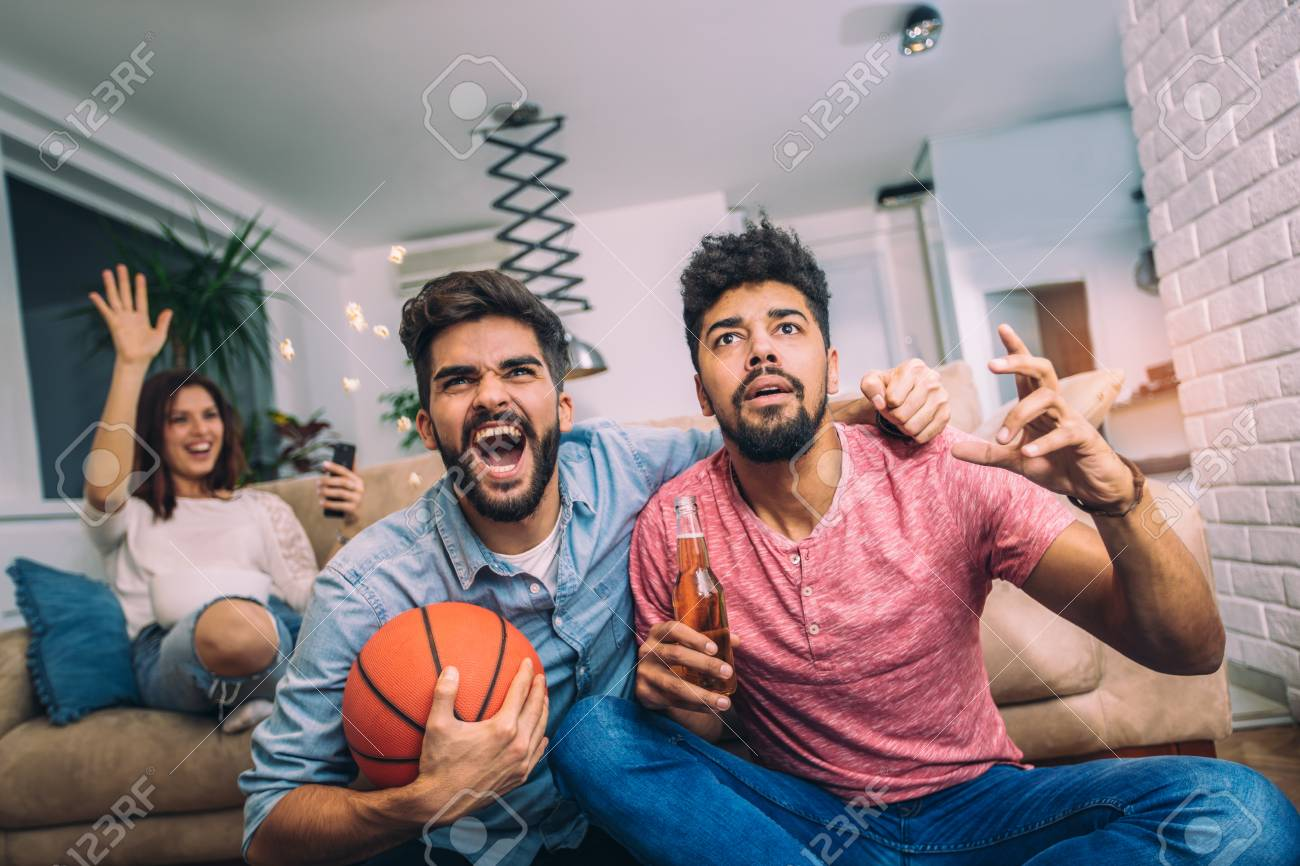 Happy Friends Or Basketball Fans Watching Basketball Game On Stock Photo Picture And Royalty Free Image Image 95393571