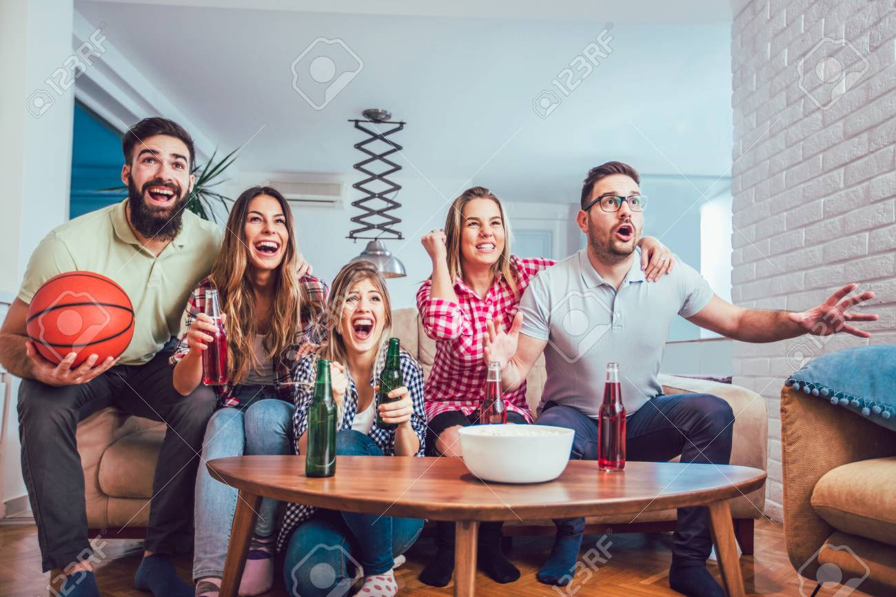 Happy Friends Or Basketball Fans Watching Basketball Game On Stock Photo Picture And Royalty Free Image Image 96121502