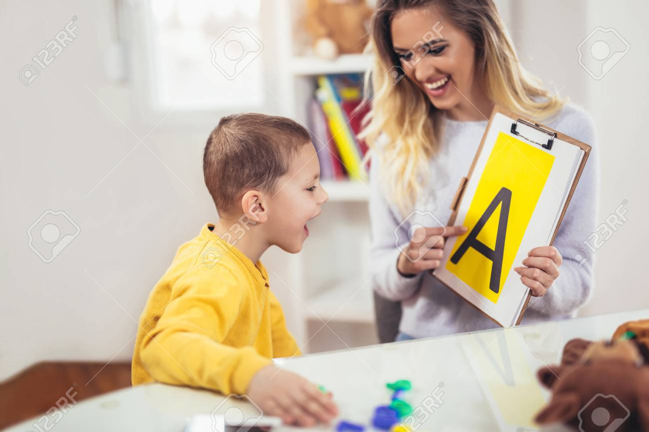 Speech therapist teaches the boys to say the letter A - 100028051