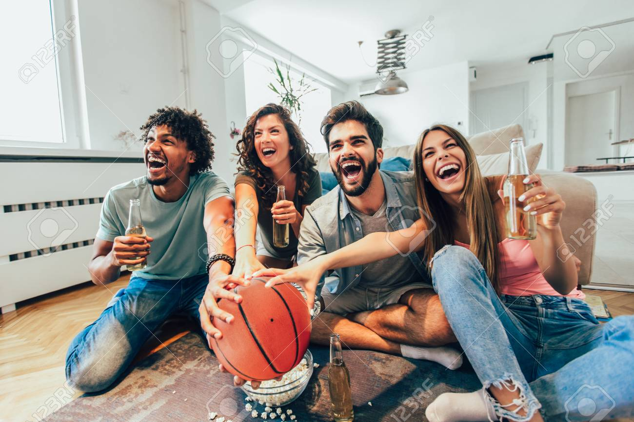 Happy Friends Or Basketball Fans Watching Basketball Game On Stock Photo Picture And Royalty Free Image Image 113251468