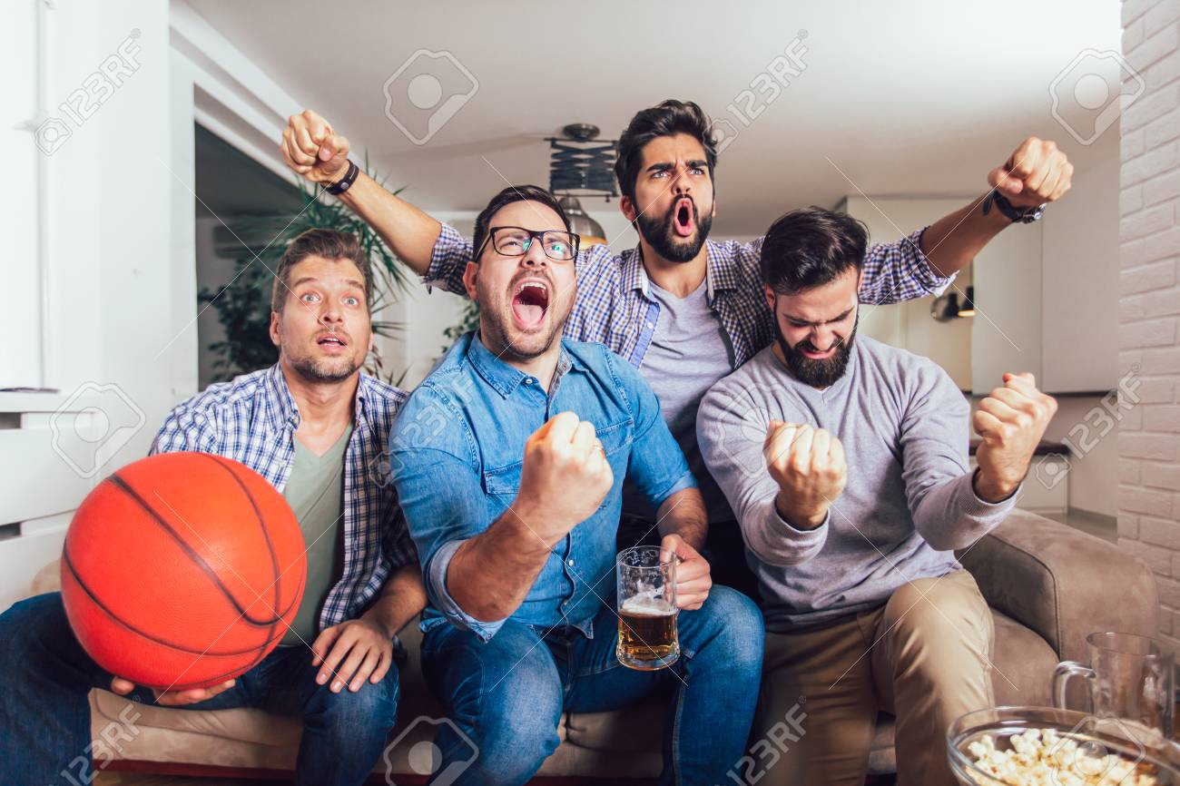 Happy Friends Or Basketball Fans Watching Basketball Game On Stock Photo Picture And Royalty Free Image Image 117581806