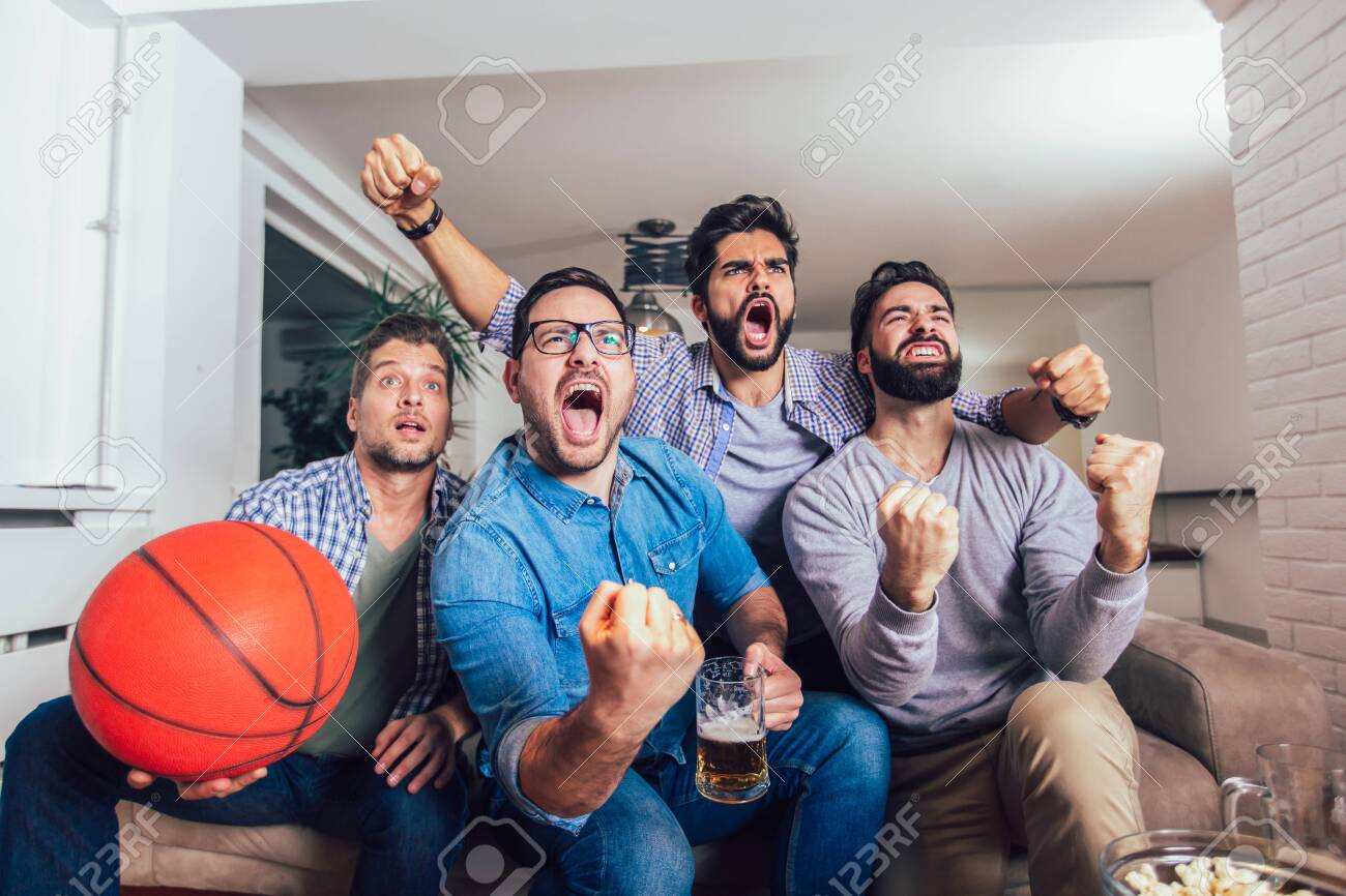 Happy Friends Or Basketball Fans Watching Basketball Game On Stock Photo Picture And Royalty Free Image Image 127237915