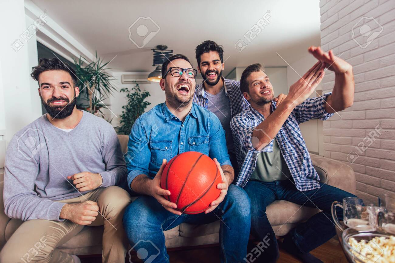 Happy Friends Or Basketball Fans Watching Basketball Game On Stock Photo Picture And Royalty Free Image Image 127239501