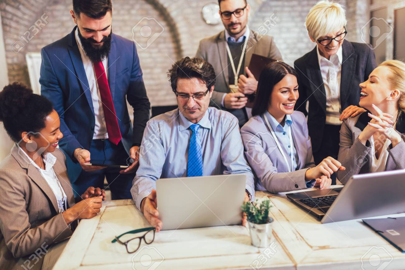 Group of business people working in office and discussing new ideas - 138588671